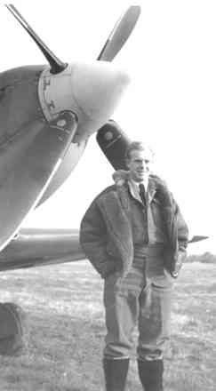 Portrait, Stanley de Vere standing in front of plane, propeller behind him - This image may be subject to copyright