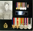 Framed portrait of Sapper Norm Leaf and his medals. - This image may be subject to copyright