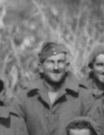Gunner Simpson, detail from Group photo, POWs in Bardia Prison Camp taken in 1941 - This image may be subject to copyright