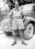 Portrait, Private Becker, standing in front of truck - This image may be subject to copyright
