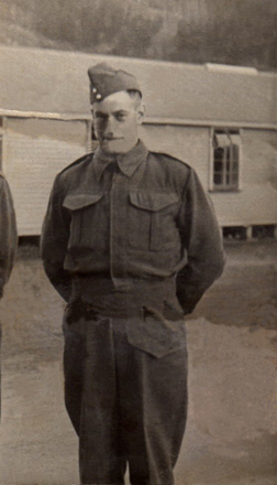 Portrait, standing outside barracks - This image may be subject to copyright