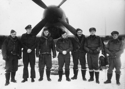 Group, WW2, RNZAF, 7 pilots from 486 Squadron standing with a tempest in winter. Image from Lee Melles collection. Caption from Sortehaug., P. (1998). p.196. Left to right: Cornelius James (Jim) Sheddan, William Alan Liddell (Bill) Trott, Brian John O' Connor, Arthur Ernest (Spike) Umbers, John Edward (Johnny) Wood, Colin James McDonald and William Lister (Dusty) Miller - This image may be subject to copyright