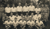 Group, WW2, A Company, 34th Battalion [Rugby] Football Team Back row, left to right: Ken, C. Bennett, W. Carey, A. Myers, Ron F. Bryers, H. C. Wynyard, S. G. Malaquin, H. Collins, Bob Rae. Middle row, left to right: [C. B. Connery not likely], Tex McGovern, Ken J. Hughes, T. V. Bedelph, Captain, Bart E. Innes, Leo Hand, Eddie Hazelton. [C. B. Connery probable] Front row, left to right: N. E. Lythe, H. Buscombe, W. J. Keith, R. J. H. Pickering, Charles E. Hazelton. - This image may be subject to copyright