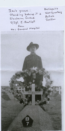 Sergeant E. Bartlett from No. 1 General Hospital standing behind the grave, Heliopolis, wooden cross and wreath, of his friend Ian Newton Bennett Paine (16009) kia 1942. (photo kindly provided by the family of I.N.B. Paine) - This image may be subject to copyright