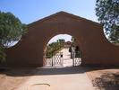 Entrance to Knightsbridge Cemetery, Libya (photo Mrs Downing 2005) - This image may be subject to copyright