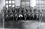 Large group soldiers seated, Fairlie in back row and is sixth from right. - No known copyright restrictions