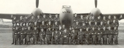 487 Squadron seated under Mosquito, Sculthorpe, October 1943. Hugh Mackay is 8th from the left in the back row. - This image may be subject to copyright