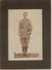 E. Welch, full length portrait, boots, bandolier, hat in hand - No known copyright restrictions