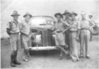 Group, WW2, 6 soldiers, some in shorts, standing in front of General Freyberg's Packard car, NZ insignia on windscreen: From left, Ray Porter (14265), Len Payne, Dave Burnand, Ian Ferguson and 'Skin' Moore (all NZ Hats). - This image may be subject to copyright