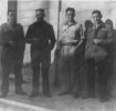 Group photograph, 4 soldiers standing on a street, Ronald Cumber and friends (kindly provided by family) - This image may be subject to copyright