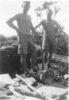 Group 2 soldiers, Jack and Ian digging slit trenches in Fiji. - This image may be subject to copyright