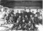 Group soldiers, inside barracks, Featherston Camp, one with an accordion. James is at left in the middle row. - No known copyright restrictions