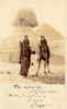 """Portrait of Frederick Varnham and another officer with an Arab man and child accompanying them. Handwritten message on photograph reads: """" The Sphinx 6th June 1915 with best love from Stuart"""". Image may be subject to copyright restrictions"""