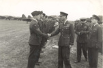 King George VI, shaking hands with an unidentified New Zealand airman (487 Squadron May 1943) - This image may be subject to copyright