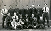 Joseph Gaunt and The Armourers 75 Squadron at Feltwell in 1940. Group photograph L to R. Back Row : Adrian Styles, Derek Morris, ?, G. Fenton; Kane; Bert Simmonds, Nesbitt, Jones; Vic Trott; Middle : McClure, Jackson, Hart, Taylor, Longstaff; Front : ?; Dyson, ?, Priestley, Joe Gaunt. - This image may be subject to copyright
