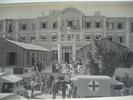 Stretchers with men being loaded into ambulances in front of Grand Central Hotel Helwan Egypt (cWW2) from collections of Jack and Madge (nee Tyson) Callaghan - This image may be subject to copyright