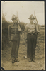 Group, 2 soldiers, standing at attention with rifles, Jackson Bray Penno (632826) left unknown soldier right - This image may be subject to copyright