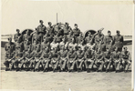 Group, formal photo in front of plane, 1943 Morley front row, eighth from left, 1943. Waiting for posting to the United Kingdom. - This image may be subject to copyright