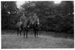 Group, WW1, 2 soldiers on horseback in the countryside, large hedge behind the pair, Dickinson, Thomas Harry (Harry) 10725, Lieutenant and his batman (name unknown), France - No known copyright restrictions