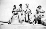 Group, WW2, 5 soldiers on a tank: Sgt Stan Hughes, L/c Jock Mansell, Major G. Baker, Trooper Peter Bankham, Trooper Henry G.C. - This image may be subject to copyright