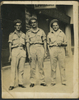 """Group, 3 soldiers in a street, all with cigarettes in their hands, Jackson Bray Penno (632826) standing far left. Message on rear: """"Taken first Leave Cairo Bill Prout, 'Lofty' Jim Simpson, and your better half Love Jack 21 May 1945"""" - This image may be subject to copyright"""