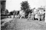 Group, WW2, 3 soldiers leaning against a tank, other soldiers in the background, second tank behind a tree, San Georgio, Italy - This image may be subject to copyright