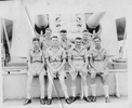 Group, WW2 seamen in tropical uniform sitting in front of a gun turret - This image may be subject to copyright