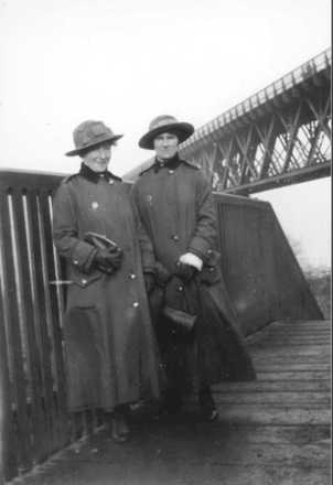 Staff Nurses Mildred Jackson 22/406 (left) and Margaret McIlwraith 22/418 (right) standing beneath the Firth of Fourth Bridge, Scotland. Date unknown. Image has no known copyright restrictions
