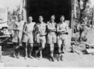Group, WW2, 5 soldiers in shorts, 2 in shirts, leaning against the tailboard of a truck - This image may be subject to copyright