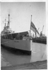 HMNZS Bellona moored at wharf, white ensign flying at half mast - This image may be subject to copyright