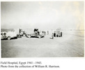 Field Hospital, Egypt, 1941-1943 showing Red Cross truck and tents, people. - This image may be subject to copyright
