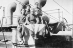"Troopship, Athenic 1917, Group on deck, 5 men, caption "" Div Sign"". William Young holding flags in the centre front - No known copyright restrictions"