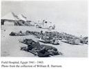 Field Hospital, Egypt, 1941-43, showing Red Cross truck and tents and patients on stretchers. - This image may be subject to copyright