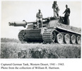 German tank, being inspected by New Zealanders, possibly 5 Field Ambulance personnel, Western Desert, 1941-43. - This image may be subject to copyright