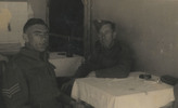 Unknown solider and Cedric Seaton Pierce at table. c. Second World War. This image may be subject to copyright.