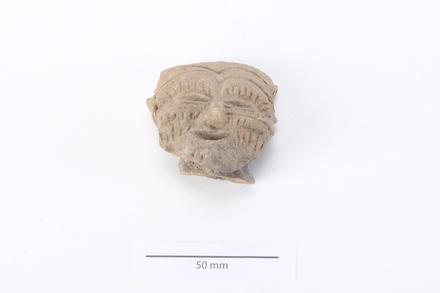 head, figurine 2012.19.310