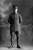 Full length portrait of Lance Corporal Adair of the 28th Reinforcements, probably (Corporal in the roll) George William Adair, Reg No 54797, E Company. (Photographer: Herman Schmidt, 1917). Sir George Grey Special Collections, Auckland Libraries, 31-A3984. No known copyright.