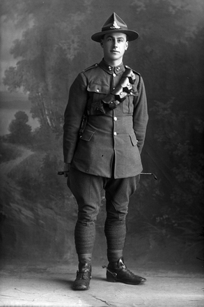 Full portrait of Gunner Armiger of the New Zealand Field Artillery. (Photographer: Herman Schmidt, 1920). Sir George Grey Special Collections, Auckland Libraries, 31-A4010. No known copyright.