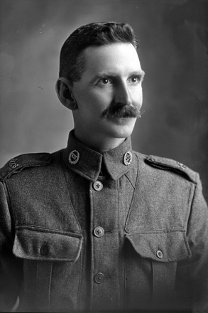 1/4 portrait of Private Harry Bethell, Reg No 23955, of the Auckland Infantry Battalion, - A Company, 13th Reinforcements. (Photographer: Herman Schmidt, 1916). Sir George Grey Special Collections, Auckland Libraries, 31-B91. No known copyright.