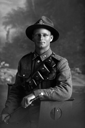 3/4 portrait of Driver George Bernard Bridle, Reg No 12734, with the New Zealand Field Artillery. (Photographer: Herman Schmidt, 1916). Sir George Grey Special Collections, Auckland Libraries, 31-B130. No known copyright.