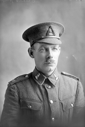 1/4 portrait of Rifleman James Brewin, Reg No 25/489, with the 3rd Battalion, A Company, New Zealand Rifle Brigade. (Photographer: Herman Schmidt, 1916). Sir George Grey Special Collections, Auckland Libraries, 31-B137. No known copyright.