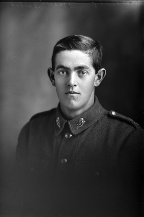 1/4 portrait of Private Bertie Edwin Beeby 15th reinforcements, J Company. Reg. No. 17747. (Photographer: Herman Schmidt, 1916). Sir George Grey Special Collections, Auckland Libraries, 31-B1439. No known copyright.