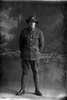 Full length portrait of Private Bertie Edwin Beeby Reg. No. 17747 15th reinforcements, J Company (Photographer: Herman Schmidt, 1916). Sir George Grey Special Collections, Auckland Libraries, 31-B1440. No known copyright.