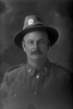 1/4 portrait of Edwin George Bartlett, Reg No 40482, Auckland Infantry Regiment, - A Company, 23rd Reinforcements. (Photographer: Herman Schmidt, 1916). Sir George Grey Special Collections, Auckland Libraries, 31-B2380. No known copyright.