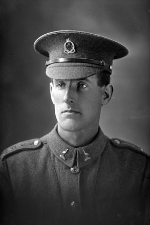 1/4 portrait of Private Richard Bell, Reg No 38646, E Company, 22nd reinforcements, Wellington Infantry Regiment. Killed in action in France 27 Mar 1918. (Photographer: Herman Schmidt, 1916). Sir George Grey Special Collections, Auckland Libraries, 31-B2383. No known copyright.