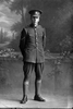 Full length portrait of Lance- Corporal Ernest Robert Baker, Reg No 46260, Auckland Infantry Regiment, - A Company, 25th Reinforcements. (Photographer: Herman Schmidt, 1917). Sir George Grey Special Collections, Auckland Libraries, 31-B2669. No known copyright.