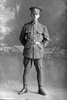 Full length portrait of Private Alexander Angus Bell, Reg No 44892, Specialist Company, Signal Section. (Photographer: Herman Schmidt, 1917). Sir George Grey Special Collections, Auckland Libraries, 31-B2685. No known copyright.