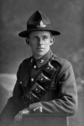3/4 portrait of Gunner Arthur George Bettany, Reg No 43012, New Zealand Field Artillery. (Photographer: Herman Schmidt, 1917). Sir George Grey Special Collections, Auckland Libraries, 31-B2687. No known copyright.