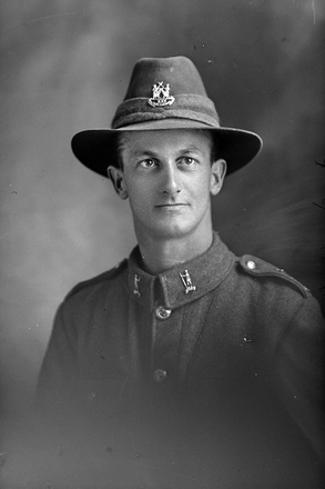 1/4 portrait of Lance-Corporal Roland Melville Becroft, Reg No 46268, Auckland Infantry Regiment, - A Company, 25th Reinforcements. (Photographer: Herman Schmidt, 1917). Sir George Grey Special Collections, Auckland Libraries, 31-B2984. No known copyright.