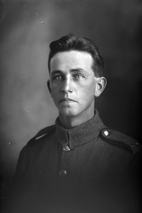 1/4 portrait of Private Edwin Bailey ('Jack') Doidge, Reg No 12/3298, 8th Reinforcements, Auckland Infantry Battalion. Later Corporal. Killed in action in France 21 Feb 1917. (Photographer: Herman Schmidt, 1915). Sir George Grey Special Collections, Auckland Libraries, 31-D404. No known copyright.